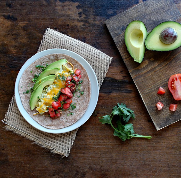 Breakfast Burrito with Eggs, Tomato, and Avocado makes a healthy and satisfying breakfast filled with high quality protein, healthy fats, and tasty veggies.