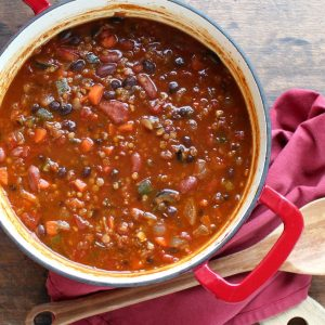Vegetarian Chili with Red Lentils - Cold days call for a bowl of warm, spicy chili. This healthier vegetarian chili calls for red lentils and lots of veggies instead of meat - perfect for meatless Mondays or any day of the week!