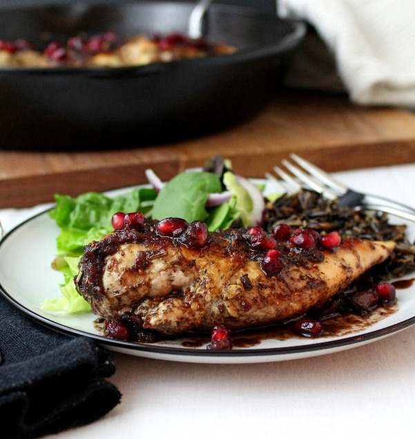 Pomegranate-Cranberry Chicken - Tender cooked chicken breasts topped with a sweet and spicy pomegranate-cranberry sauce with just the right touch of heat.