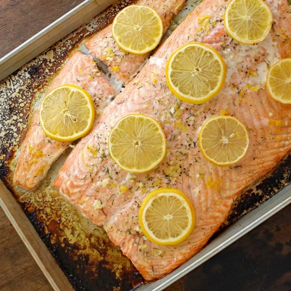 Seasoned with lemon, garlic, and dill, Baked Salmon with Lemon-Dill Sauce is nourishing, heart healthy, delicious, and quick and easy to prepare.
