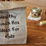 "A brown paper lunch sack with the words ""Healthy Lunch Box Ideas for Kids"" on the front"