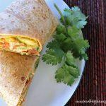 Closeup of a sliced Tomato & Mango Chicken Salad Wrap