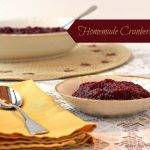 "The words ""Homemade Cranberry Sauce"" over a photo of a dessert bowl of sauce with a napkin and spoon"