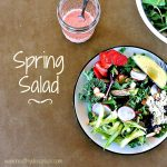 "The words ""Spring Salad"" next to a bowl of salad and a jar of vinaigrette"