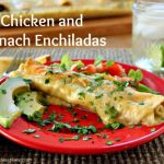 "The words ""Chicken and Spinach Enchiladas"" above an enchilada on a red plate"