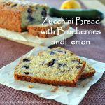 "The words ""Zucchini Bread with Blueberries and Lemon"" over a photo of the bread"