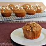 "The words ""Pumpkin Chai Muffins"" over a photo of a muffin on a white plate"
