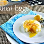 "The words ""Baked eggs"" over a photo of an egg on a white plate"