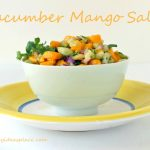 Cucumber Mango Salsa in a white bowl from a side angle