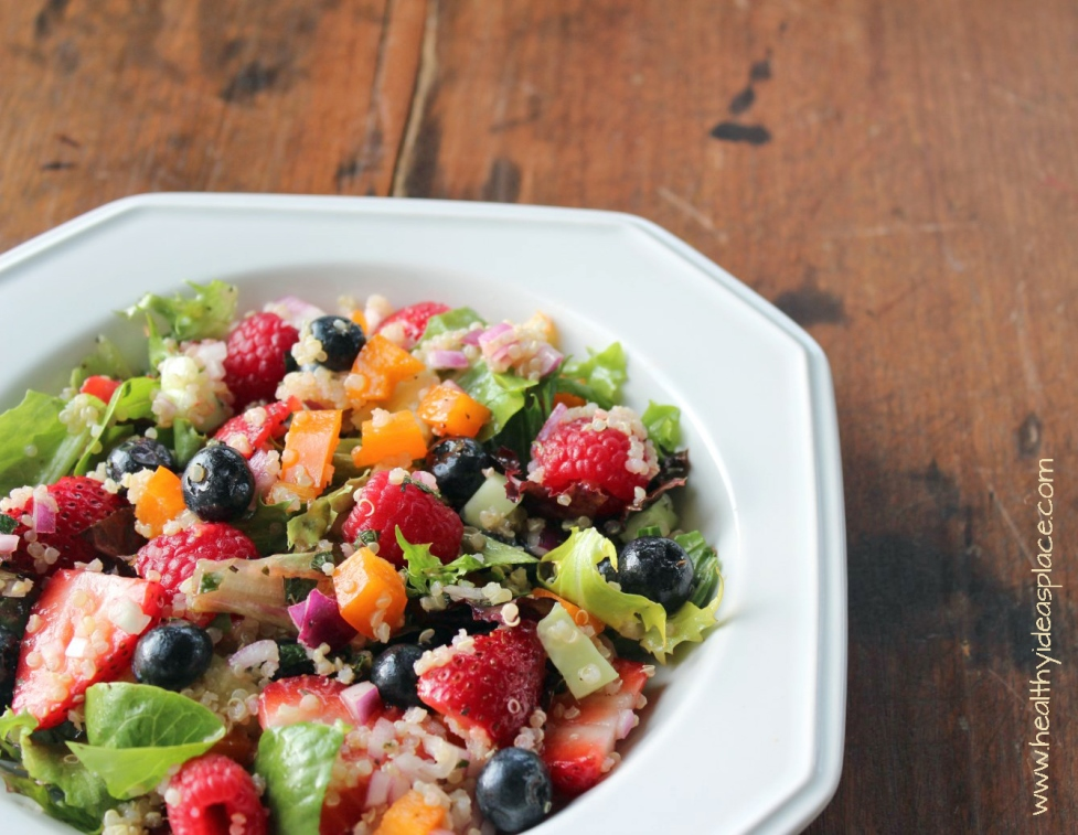 Triple Berry and Quinoa Salad with Mixed Greensplaces sweet berries and nutty quinoa amidst a backdrop of earthy mixed greens, cucumbers, and peppers, all pulled together with abalsamic vinaigrette for a colorful and scrumptious salad.