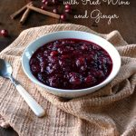 "The words ""Cranberry Sauce with Red Wine and Ginger"" above a photo of the sauce in a white bowl"