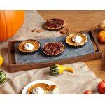 A soapstone platter with three tarts on it