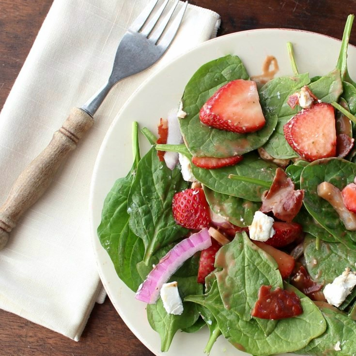 Strawberry Spinach Salad with Crispy Prosciutto - A delectable salad filled with spinach and strawberries, and topped with prosciutto and homemade vinaigrette