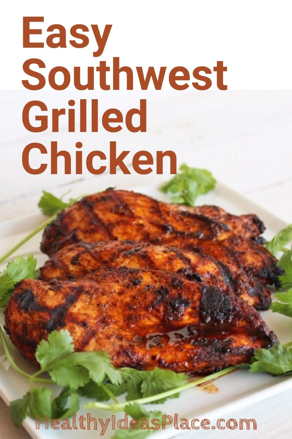 Grilled chicken and fresh cilantro on white plate