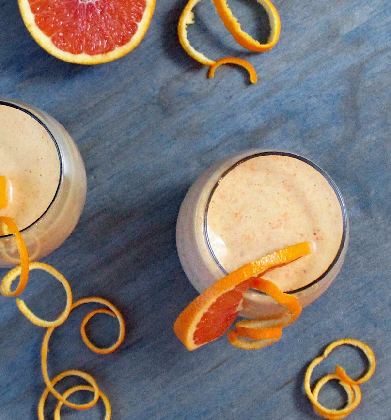 Orange and Carrot Smoothie with Ginger and Turmeric - This healthy orange and carrot smoothie is blended with ginger and turmeric for an immune boosting, creamy, and delicious smoothie. Just right for a nourishing breakfast or snack.