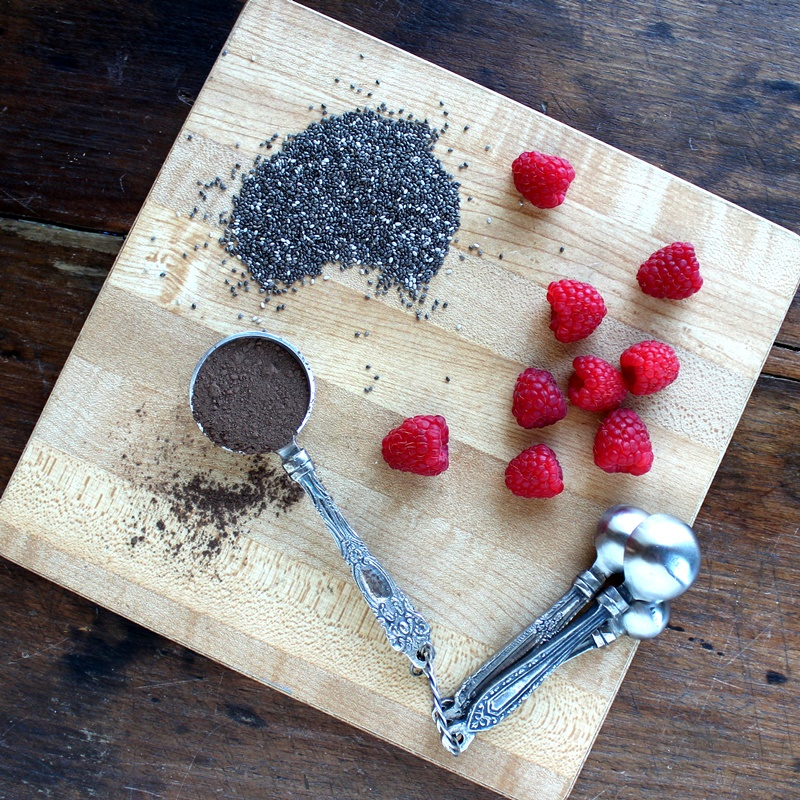 Dark Chocolate Chia Seed Pudding with Raspberries - This chia seed pudding is filled with flavor as well as heart healthy ingredients and makes a satisfying mid-afternoon snack or a decadent dessert elegant enough for that special dinner for two.