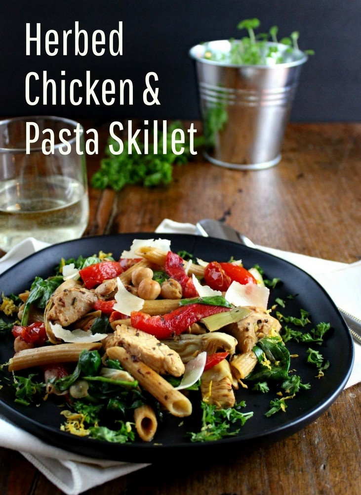 Herbed Chicken and Pasta Skillet with Blistered Tomatoes, Artichokes, and Spinach - This skillet dinner recipe is packed with nourishing vegetables and chicken seasoned with a lemon and herb marinade. Delicious, colorful, and easy to make!