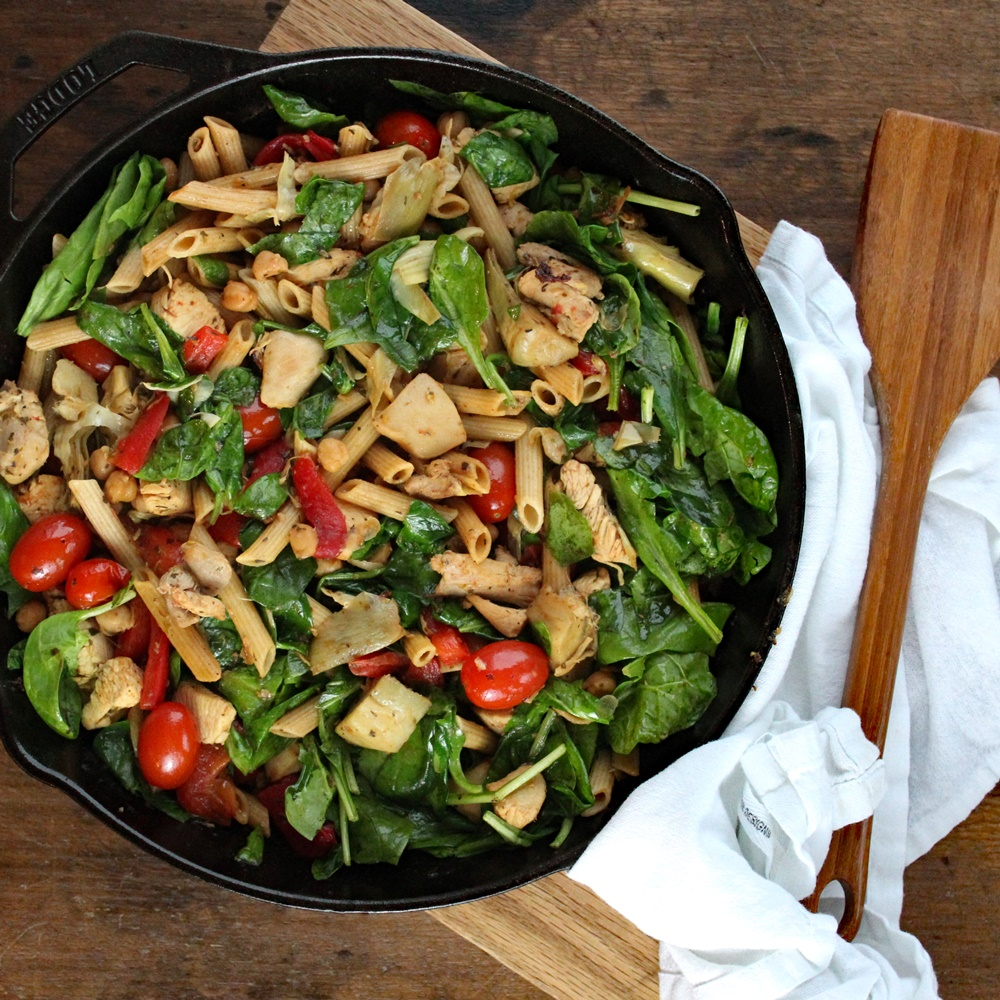 Herbed Chicken and Pasta Skillet with Blistered Tomatoes, Artichokes, and Spinach – One pan dinners move over. This delicious skillet dinner recipe is still simple to make, filled with flavor, eye appealing color. So good!