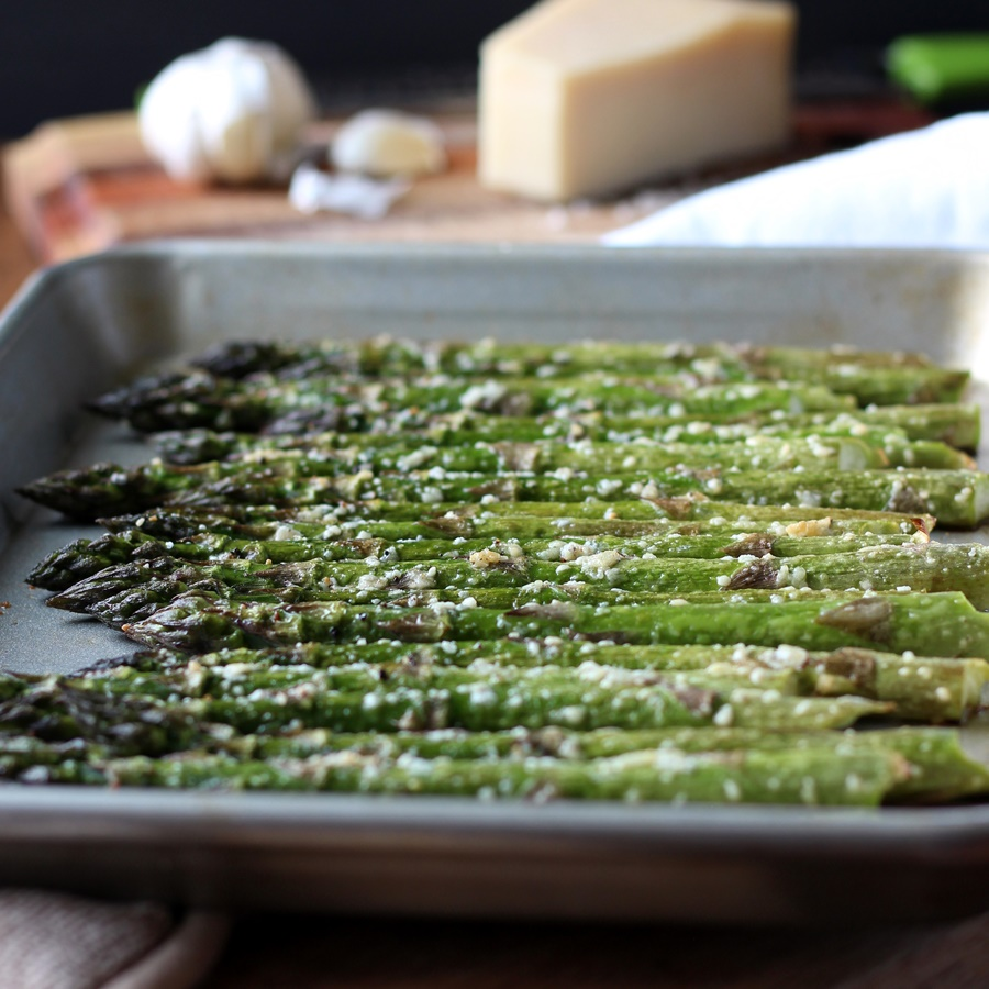 Roasted Asparagus with Parmesan and Garlic – So easy to make for dinner! Fresh asparagus is roasted until tender and seasoned with parmesan and garlic. Simple and delicious recipe!