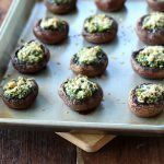 Stuffed Mushrooms with Spinach and Parmesan - on a baking sheet, fresh from the oven