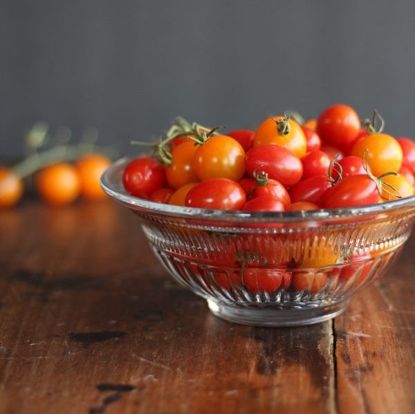 Bowl of red and yellow grape tomatoes