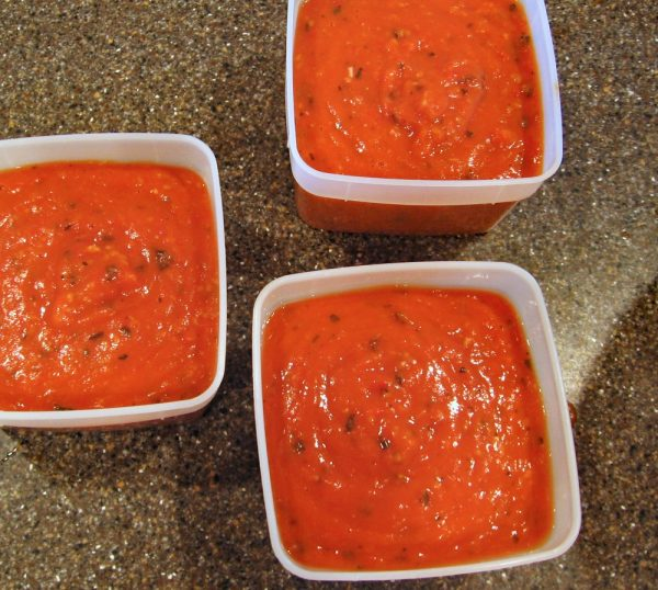 Roasted cherry tomato sauce in freezer boxes