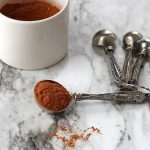 Southwest seasoning in a tablespoon on a marble background