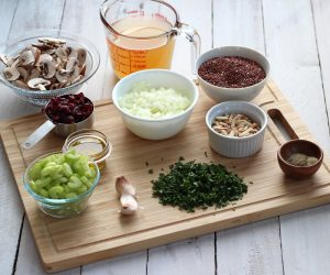 stuffing ingredients on wood cutting board on white background