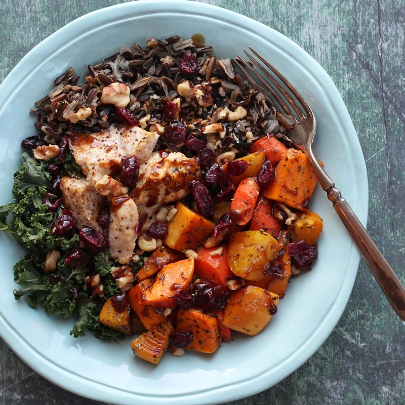 Rice, winter vegetables, kale, and chicken in teal bowl