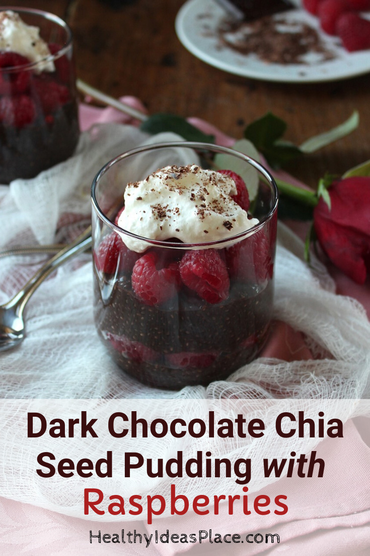 Dark chocolate pudding dessert with raspberries in clear glass