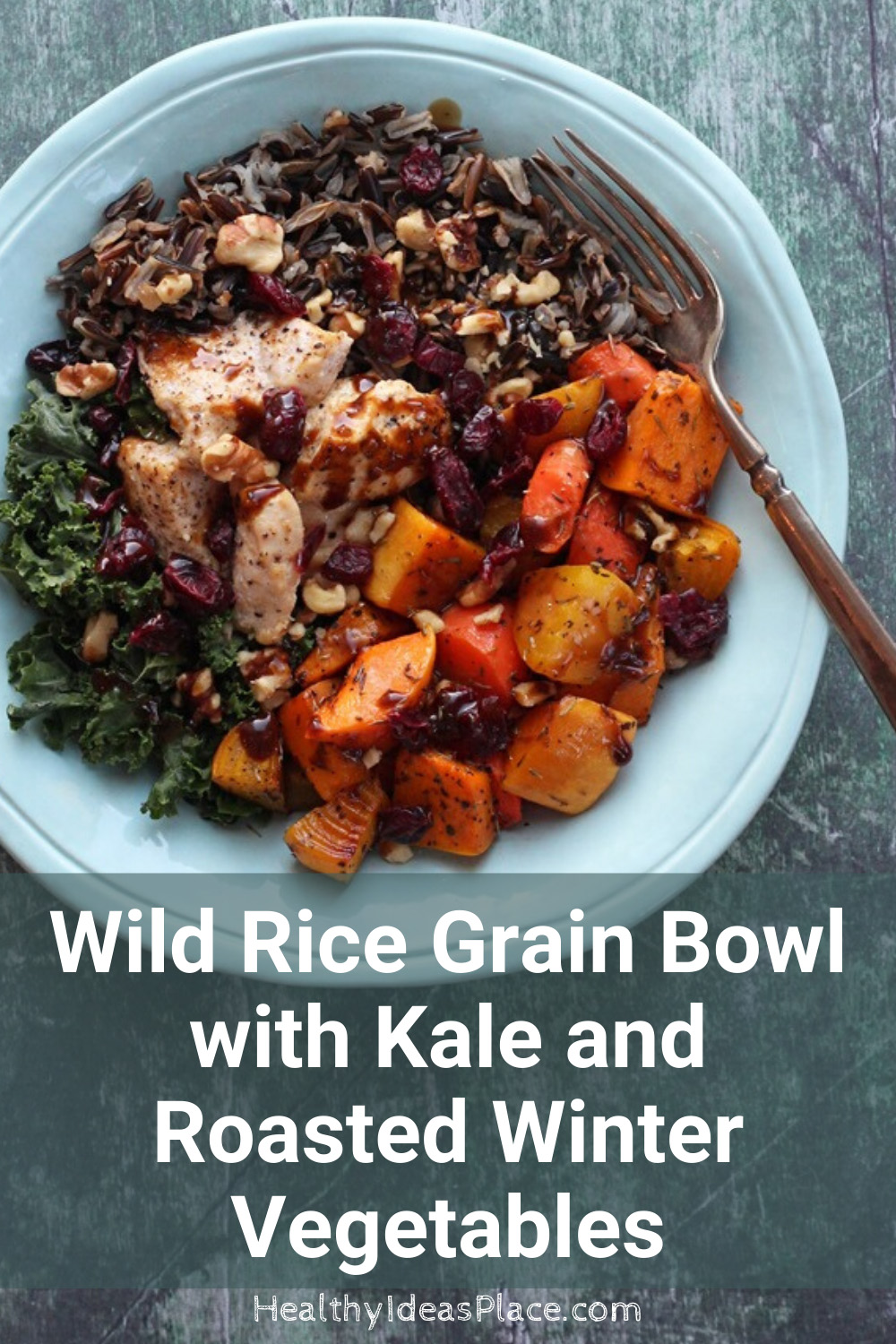 Teal bowl with kale, wild rice, winter vegetables, and chicken