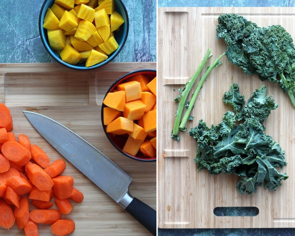 Carrots, squash, beets, and kale on cutting boards