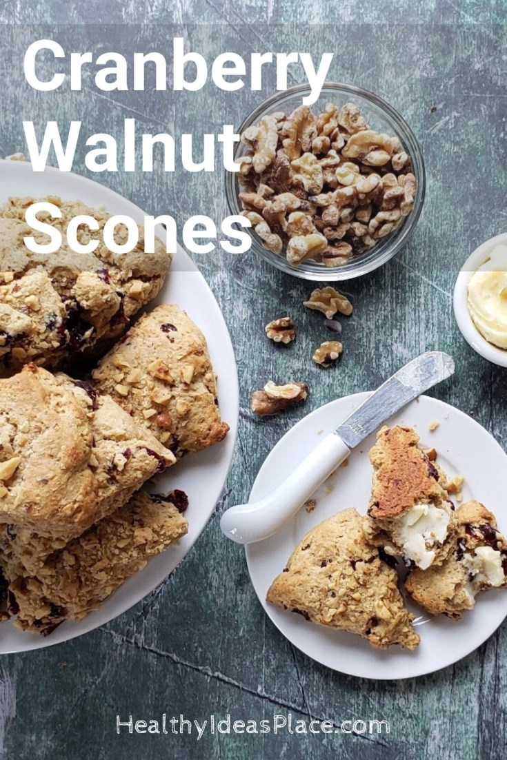 scones on white plate with walnuts in the background