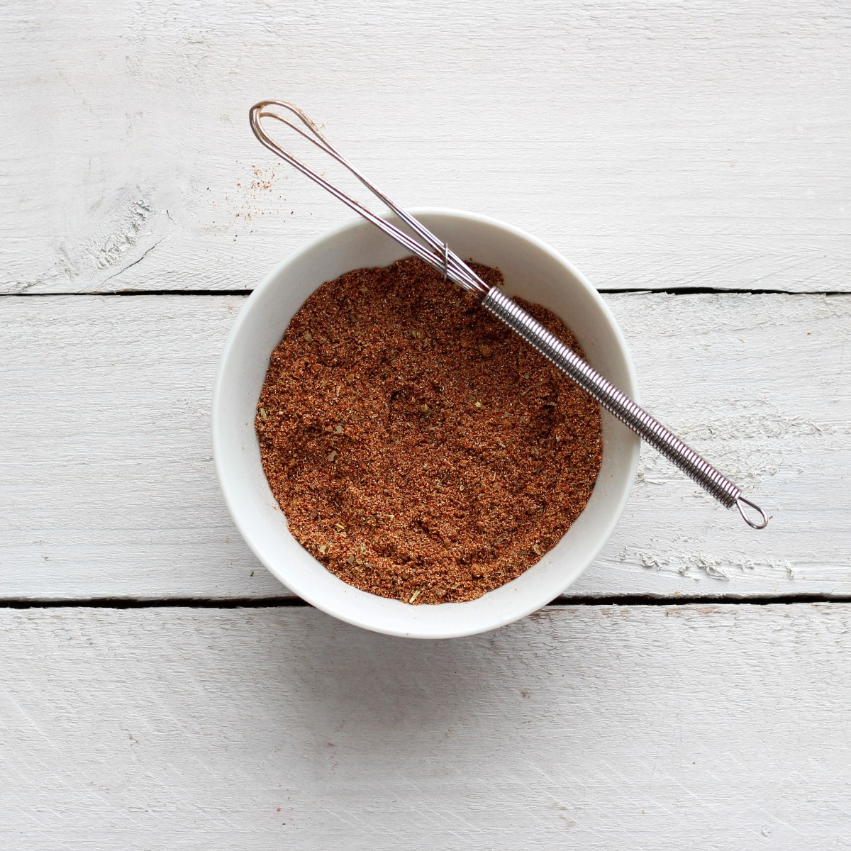 Spice mix in white bowl on white backgrond