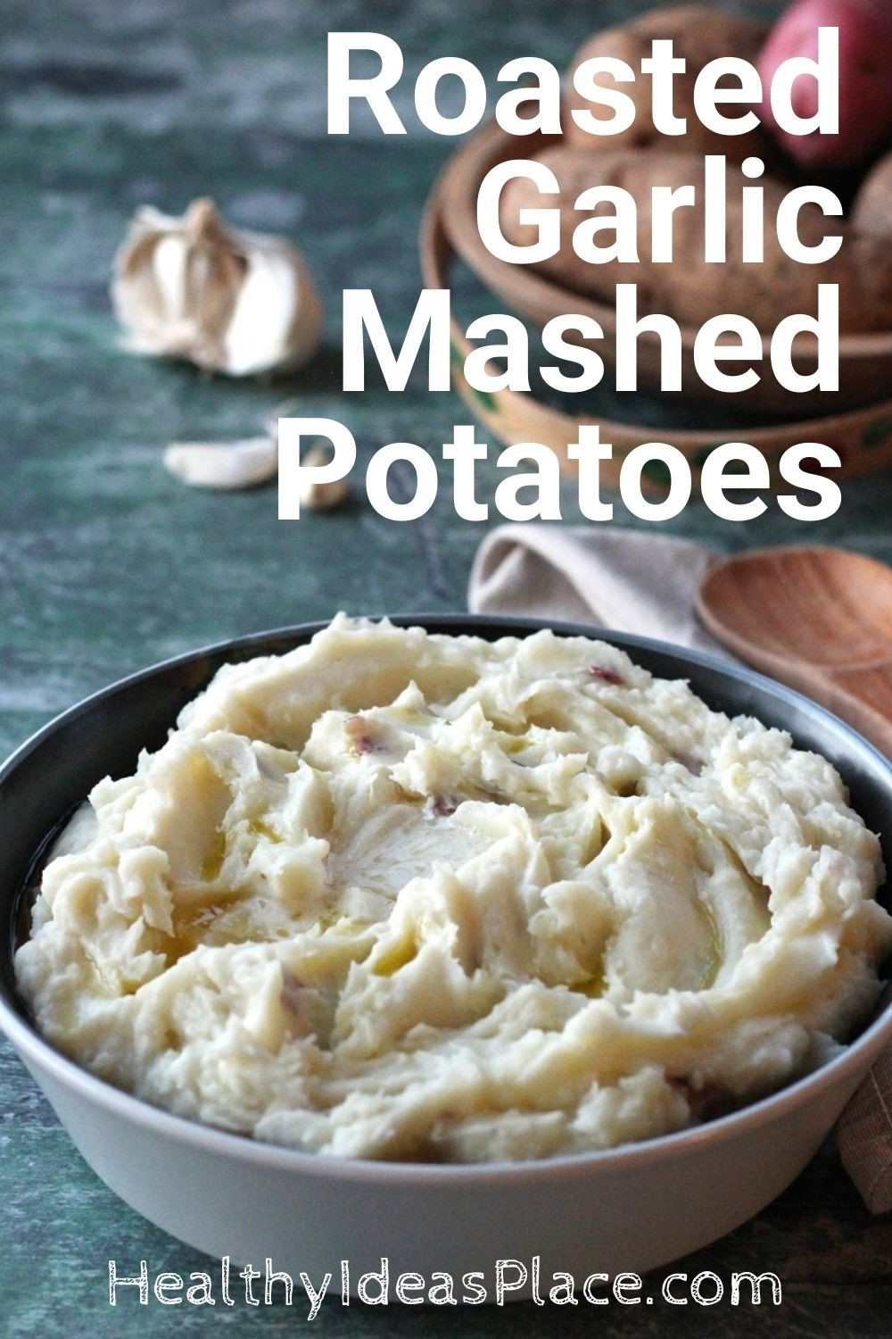 Mashed potatoes in bowl against green background
