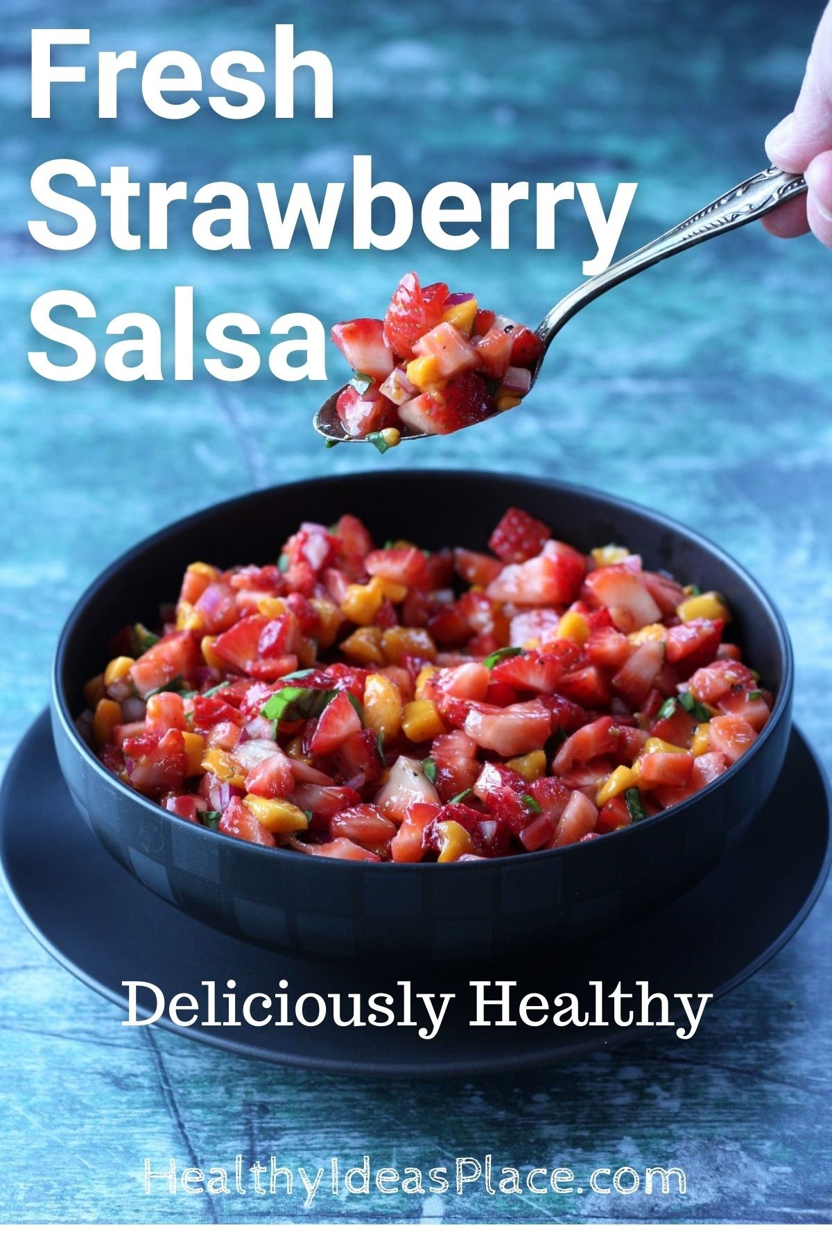 diced strawberries as a salsa in black bowl